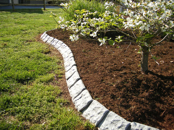 Decorative stone garden edging at yard product for Unique garden border ideas